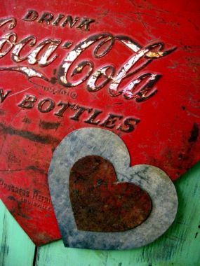 The perfect Valentine for your Love Shack. All the hearts are cut from the sheet metal of an old Coca-Cola cooler.