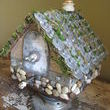 Here she is, my little ten ton beauty. I glued moss to all of the exposed wood to add charm. Do you love the door?