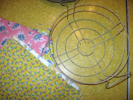 I started with an old canning jar lifter and some vintage fabrics