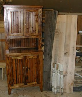 This pine pantry cupboard was made from salvaged cratewood. Next to it are the pieces of what will become an oak harvest table.