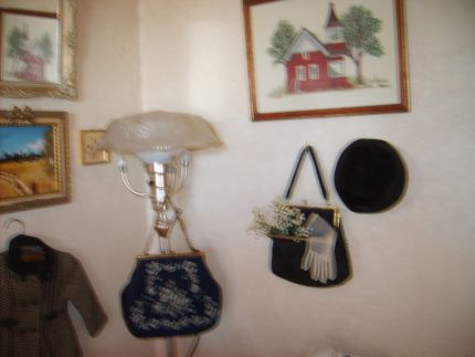 I collect vintage purses. The one on the wall holds babys breath, vintage lace gloves, next to a vintage hat.