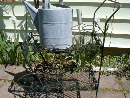 These two items were at the recycle place. I couldnt see them going to scrap so I rescued them. The tea cart had black chippy paint on top of white chippy paint.  The watering can will stay as is.