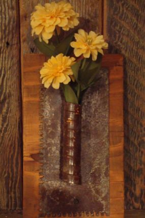for this one, I used an old rusty tool used for applying the glue for tile. I found it in a bucket of rusty old trowels out in my workshop. I LOVE the curly handle! All it needed was a sprig of silk flowers! For fresh cut blossoms, a glass or plastic test tube fits right inside too.