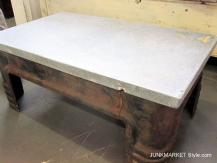 I love the sleek industrial look. The best part about this table is that it weighs about 1000 pounds. Feel free to put it outside...even in Kansas. Ha!