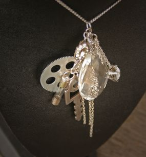 An old chandelier crystal, old key, little gear, fuse, & some chain...
