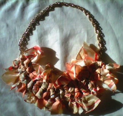 Vintage scarf knotted and sewn, attached to vintage gold necklace!