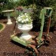 Thought I may as well share with you some of my metal green gardenware obsessions.  This cart, another example of very heavy metal!  The cement urn on top of it is no lightweight either.
