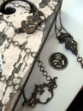 Necklaces and chokers made from antique brass drawer hardware.