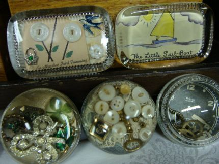 A new batch of paperweights filled with lots of goodies.  Dont ya just love the one with the four-leaf clovers (and the little sailboat)???