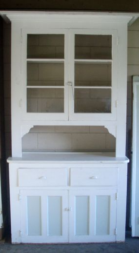 This cupboard has glass doors, layers and layers of white paint, and its 8 feet tall!