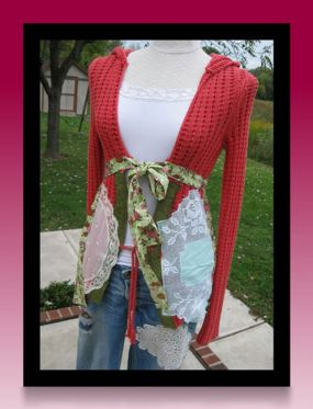 This was just a plain pull over sweater..I tore it apart and added lots of vintage doileys and fabrics and now it ties in front...So fun and cute..No more boring sweater..