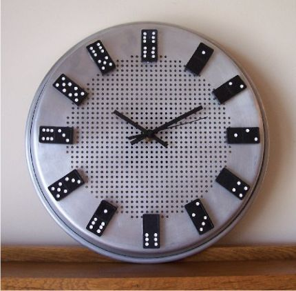 Ive had this project in mind for quite a while and finally found something round that was big enough to look good with the dominoes and deep enough to hold the clock works.