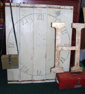 Here is the finished clock with flea finds and tin foil H.