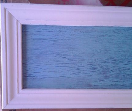 I distressed a piece of particle board and added some trim to it. I used Elmers glue to get the crackle effect.