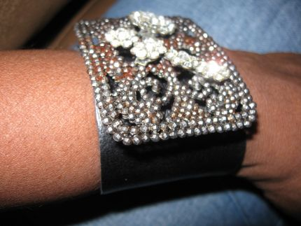 This cuff was made of a vintage shoe buckle from France...and a leather scrap I cut and added snaps. It was also adorned with a rhinestone barrette.