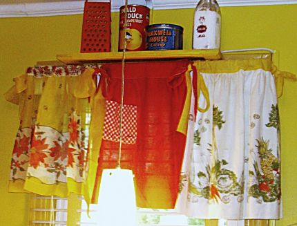 Vintage aprons used as a Window Valence