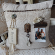 And, heres a bonus project.  A recovered pillow - muslin, lace, hardware, crystal, and a bit on the rusty side - but perfect to display keepsakes and photos.  The photo is our daughter (Kristen), son-in-law (Tom), and their sweet dog, Jersey (aka, our grandpuppy!).   FYI - the trim across the top is a mix of a rusty chain and lace - who knew they could go together so well??