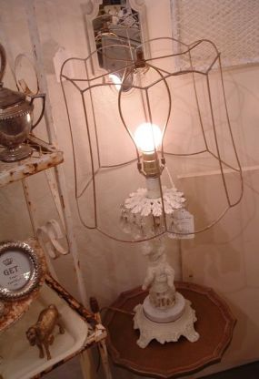 I admit I have a thing for wire, metal and rust, but my latest confession......I love a naked lampshade!!! Its raw, unexpected and so beautiful in its natural form. Its not dirty, its ART!!! Especially when it sits atop this chippy cherub lamp drenched in crystals. I was blind, but now I see.