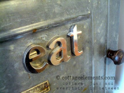 Out an about at the local occasional sales, I happened upon an uber cool industrial piece.  The price was right, but I purchased it not having a clue on where Id put it.  I think these metal letters might be a give-away on where I decided.  Can you say eat!