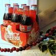 One of my fav collectibles is the Christmas case of Coke, mint condition. I still remember buying it, wondering how long Id end up keeping a new case of coke. The date on the case is 1999. Gettin there... Strung up cranberries made a really neat garland that looks great against antiques. But beware.. in about 2 weeks theyre cranraisins... hmmm...
