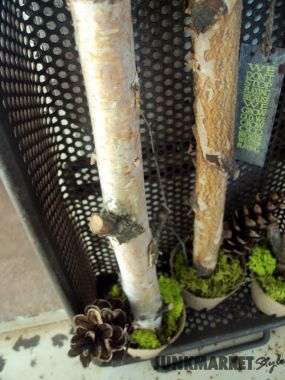 Metal baskets with holes? Imagine that! You I love know these. I mixed it with a little nature and my door decor was born.