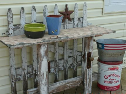 Patio table... a picket fence gate, a beadboard door (top) and chippy door pieces including the rusted hardware.