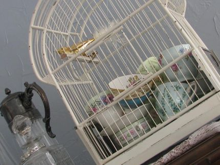 Tea for tweety bird? This vintage birdcage was originally gold. I spray painted and distressed it.