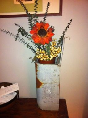 Old mailbox used as vase (in this case a vase holder).