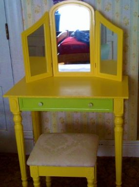 I found this vanity from Target at a garage sale. It was a boring cream color. After two years of not using it for its intended purpose (it was being used as a bedroom catch-all), I gifted it to my five-year-old self-proclaimed princess. We added some L-brackets to the mirror for safety and painted it her favorite color - bright, sunshine-y yellow. I finished the drawer in a key lime green to give it an extra punch. Boring? Not anymore...I just hope her make-up choices as she grows up are a little more tame!!
