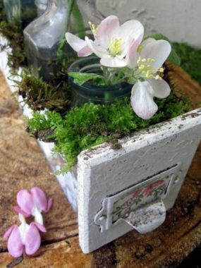 We can all find drawers and bottles right? I used a drawer that is metal and chippy wood that seemed ideal for the delicate Spring blossoms.