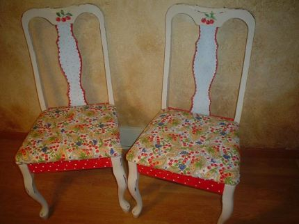 Two matching chairs that I found curbside. I covered the cushions with some cherry themed fabric and became inspired to paint the chairs to coordinate with the fabric