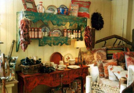 Here's a shelf and buffet table I built, painted and distressed. The pillows were created from old Beacon Blankets. This photo was taken within the first month after we opened.  There are additional photos on my Facebook page (Jim Healy JunkArchitect). Ill add more as I find them.