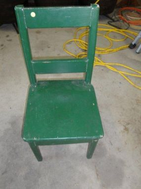 The ugly, pitiful, green chair.