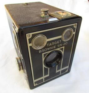 When I found this worn out Brownie Camera at a church rummage sale, the back side of the box was covered in a thick gooey substance.