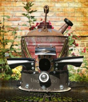 Recycled toy parts and an old galvanized gas can turn into upcycled bird house!