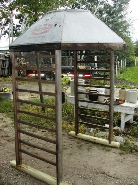 Gazebo made with a galvanized brooder hood and some old railing sections