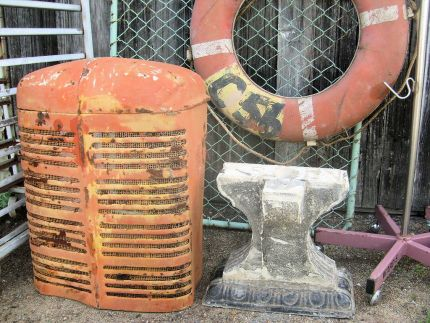 What a great lot of junk. The colours on this old tractor grill are wonderful and the concrete base thingy has me conjuring up all kinds of ideas.