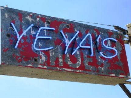 This Old Sign was removed form an Old Building being torn down and Salvaged.