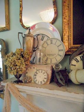 Vintage silver, old books, dried hydrangeas, glass knobs, and clock faces come together to make a neutral yet warm an inviting Fall display.