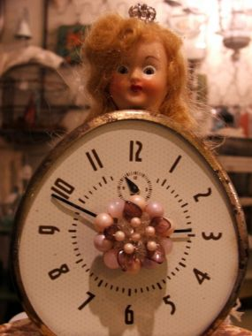 Miss get me to the church on time upcycled clock and doll head with vintage jewelry accents.