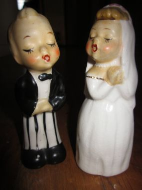 I bought these vintage salt and pepper shakers at a tag sale last year for $2. Were planning to use them as our cake topper!