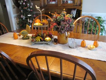 I love the beautiful colors of fall.  I choise those colors to decorate my table with dried flowers, rustic metal 2 tier trays filled with leaves, flowers, candles and pumpkins.  And the salt and pepper shakers were a great find from the good will store.