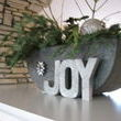 Loved, loved, loved this large galvanized container over the fire place.