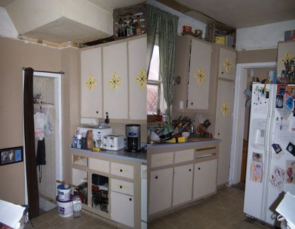 Here are the Nightmare Before pictures. Burnt countertops, lathe and plaster hanging out all over, HUGE gawdy flowers, mising doors, and a Budget of $250.00!!!!  Re-use Re-purpose Queen on her way!!!!