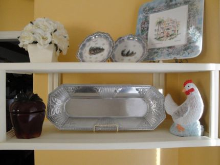 My finished shelves!  I love them.  I have a thing for plates and trays.