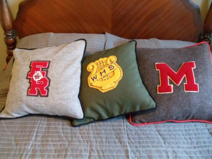 These are throw pillows I made with the H.S. Varsity Letters from my son, my husband and my husbands father.