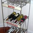 Industrial vintage store displays have great repurpose in kitchens.  And of course this one has to be a wine bar!