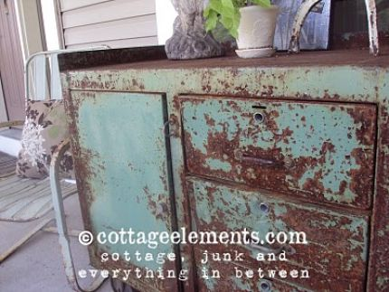 This industrial desk sits on my front porch.  It came out of some sort of factory.  Must have been quite the factory though...love the gorgeous turquoise paint!