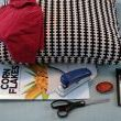 What youll need:  An existing pillow A red recycled Tshirt A cereal box (or any other recycled cardboard) Stapler Scissors A large flat surface brooch or pin Blue tack (which is white in this case)