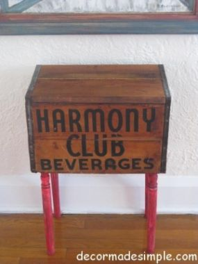 Vintage beverage box and banister spindles make a side table.